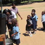 zambia-little-boy-washing-1