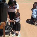 zambia-little-girl-washing-1