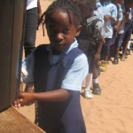 zambia-little-girl-washing